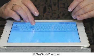 Hands closes up control a tablet - Hands closes up control a...
