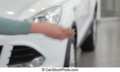 Saleswoman giving car key Auto business, car sale,...