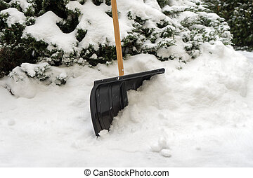 Snow Shovel - Snow shovel stuck in the snow