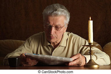 Mature man reading - Portrait of a mature man reading...