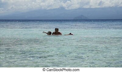 Father and daughter playing in the sea