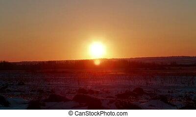 Sunrise in the field winter