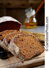 Slices of fresh rye bread on a wooden board