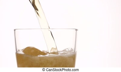 Beer being poured into glass, white isolated background -...