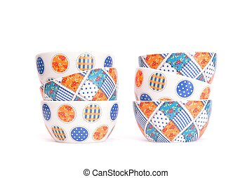 Two zigzag stacks of porcelain bowls isolated