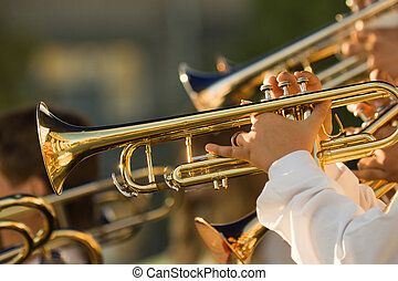 gold trombones - young musicians are playing on trombones