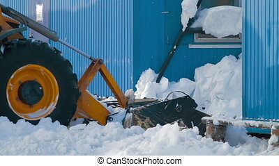 Iron snowplow pushing a lot of snow away - Removing snow...