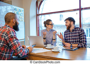 Happy people working on business meeting together -...