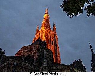 Church of Our Lady in Bruges - Illuminated tower of Church...