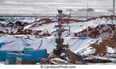 Well pad with a oil well Christmas tree equipment - Well pad...