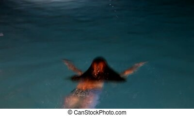 Beautiful woman the mermaid, diving in and floating in water
