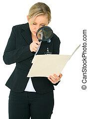 Female Caucasian Investigate A Folder - serious female...