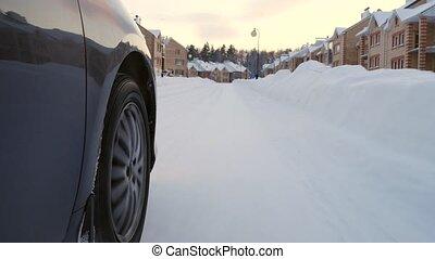 Car's Wheel on Winter Road 4K