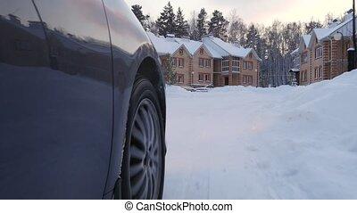 Car's Wheel through Winter Village 4K