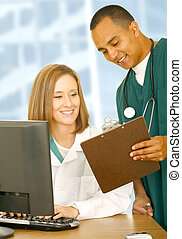 Medical People Checking Report - two medical people looking...