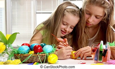Children paint Easter eggs at home - Children girl paint...