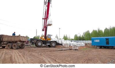 Crane loads chemistry bag - Crane loads a chemistry bag