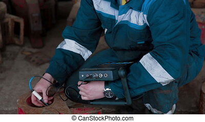 Worker tests by special Hardness metal device - Hardness...