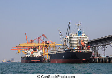 heavy container ship loading goods in commercial sea import...