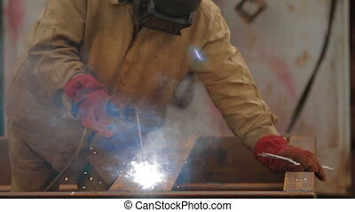 Welder at work in industrial factory - Welder at work in...