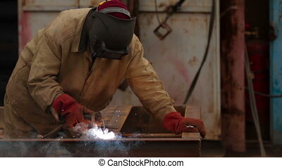Welding in a industrial factory - Welder at work in factory
