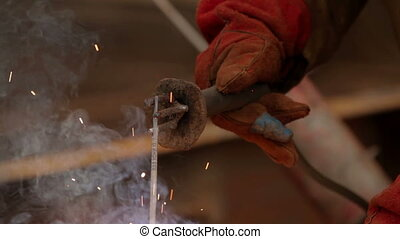 Welder at work in factory Welding process