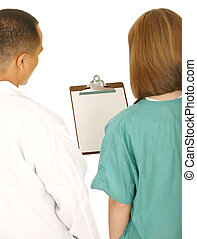 Medical Team Analyse Report - two medical staff looking at...