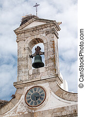 View of the famous bell tower of the main entrance to old town in Faro, Portugal.