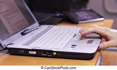 Freelancer Workplace Background - A man working at a laptop...