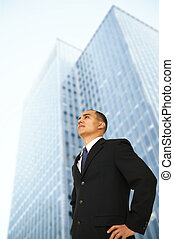 Business Man Standing By His Office Building