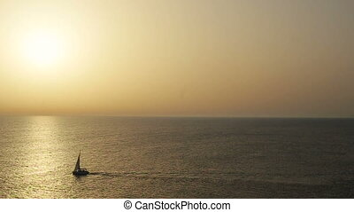 Cruise ship on a clear day with calm seas and sunset sky on...