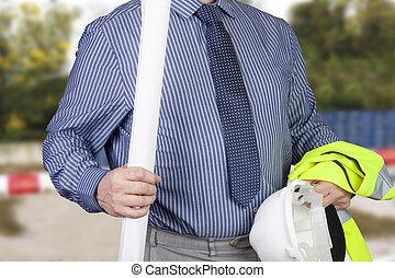 Building surveyor carrying hi vi vis vest and hard hat with...