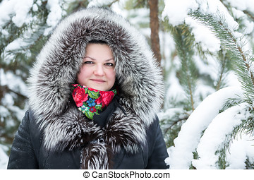 Woman stands near young pines in winter - Woman stands near...