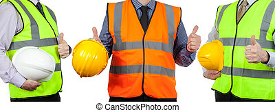 Three site surveyors in high visibility vests giving the...