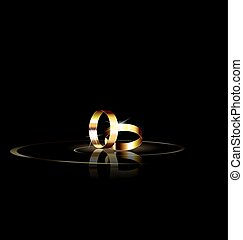 two golden rings - dark background and couple of golden...
