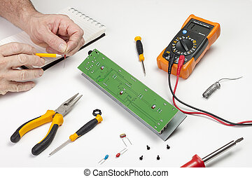Electronics engineer checking