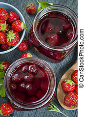 Strawberry preserve - Glass jars with homemade strawberry...