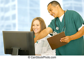 Nurse Pointing Computer Screen To Doctor - nurse in medical...