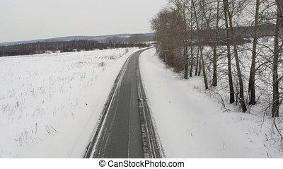 Flight over the Road in Winter 4K