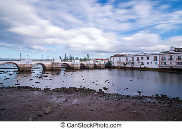 Wide view of the picturesque city of Tavira, Portugal, crossed by Gilao river.