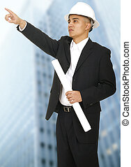 Architect Pointing With Building Background