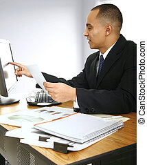 Calculating Sales - a business man looking at computer...