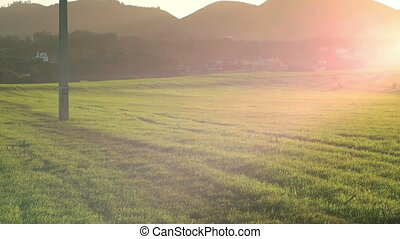 Sunset Overview of Farm During Sunset - Slow panning shot of...