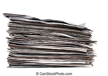 View of a pile of newspapers stacked isolated on a white background.