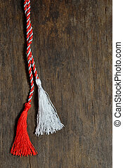 March 1 traditional trinket simbol on wooden background