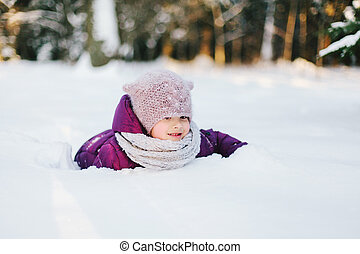 Little girl playing in snowy park - Portrait of a little...