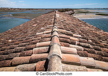 View of traditional rooftops of the Algarve region next to...