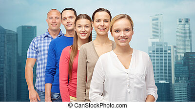 group of smiling people over city buildings - family, gender...