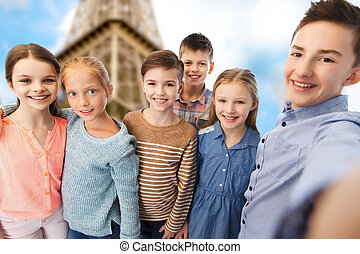 happy children talking selfie over eiffel tower - childhood,...