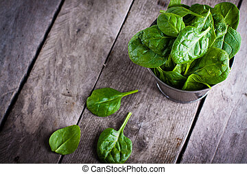 Baby spinach in metal bucket on old wooden surface Spinach...